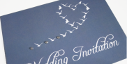 blue wedding invitation with seagulls